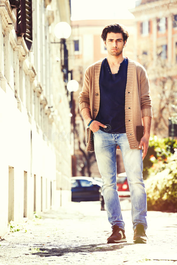 Gorgeous young men italian model outdoors, urban scene in the city stock photos