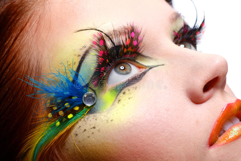 Young model beautiful women. Gorgeous Young model beautiful woman with perfect art make up and long false eyelashes made from feathers royalty free stock image