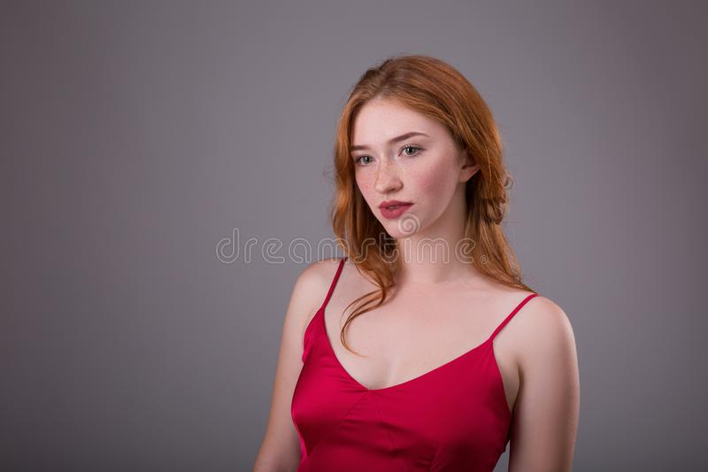 Gorgeous young redhead woman with long coppery hair. Freckles are on the face stock photos