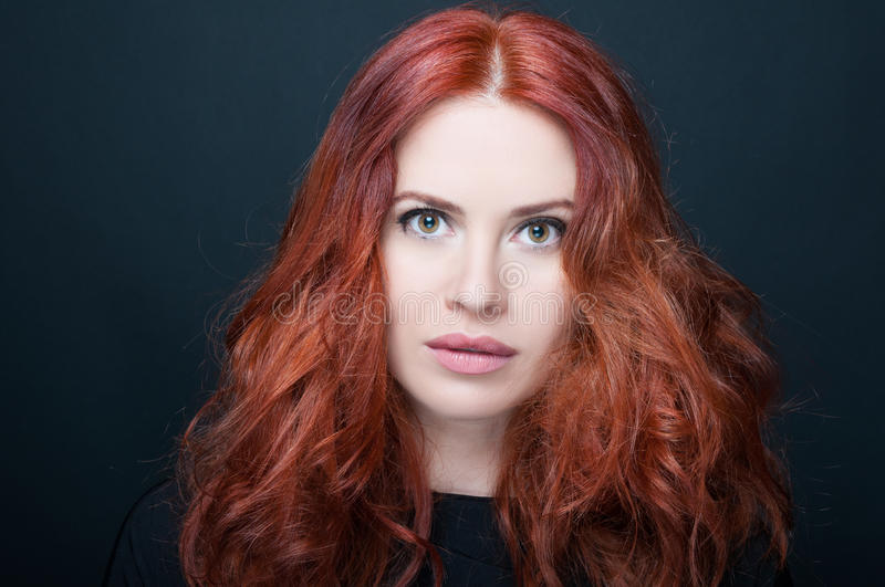 Gorgeous young woman with amazing full redhair royalty free stock photo