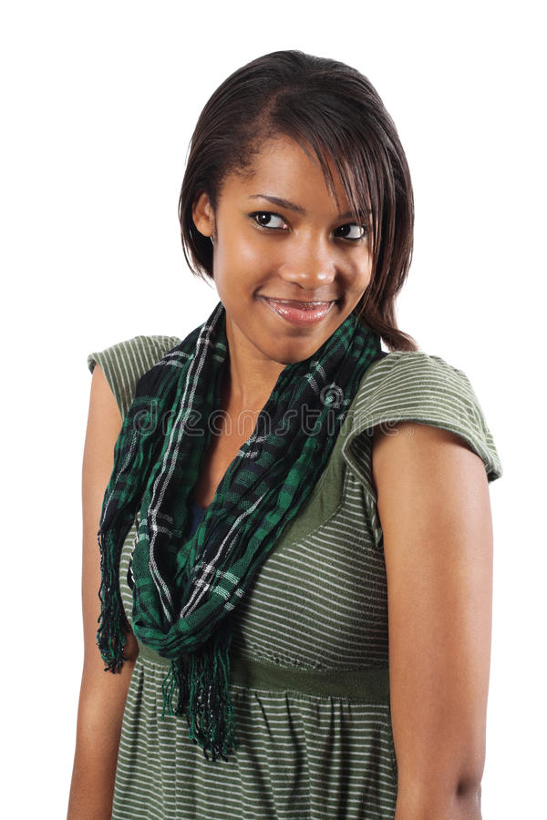 Gorgeous young woman with coy smile. Beautiful African American woman looking away over white background royalty free stock photo