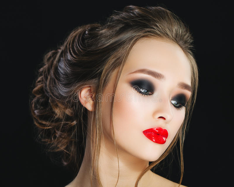 Gorgeous Young Woman face portrait. Beauty Model Girl with bright eyebrows, perfect make-up, red lips, hairstyle stock photos