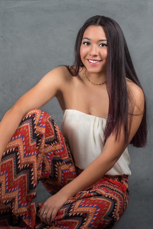 Gorgeous young woman with long dark hair stock photos