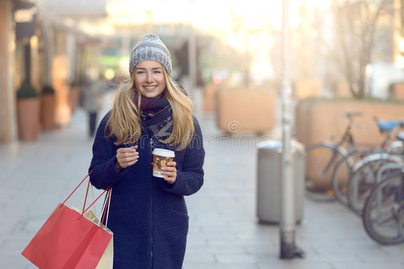 Gorgeous young woman out Christmas shopping stock image