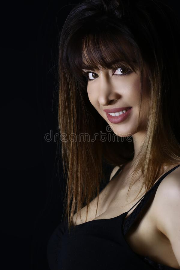 Gorgeous young woman with perfect healthy skin on black background. royalty free stock photo