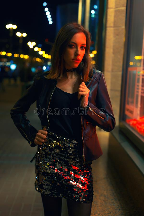 Gorgeous young woman posing at night city stock photos