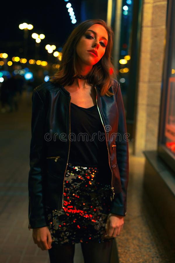 Gorgeous young woman posing at night city royalty free stock image