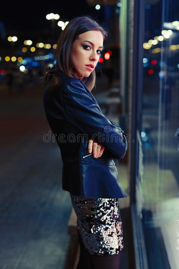 Gorgeous young woman posing at night city royalty free stock images
