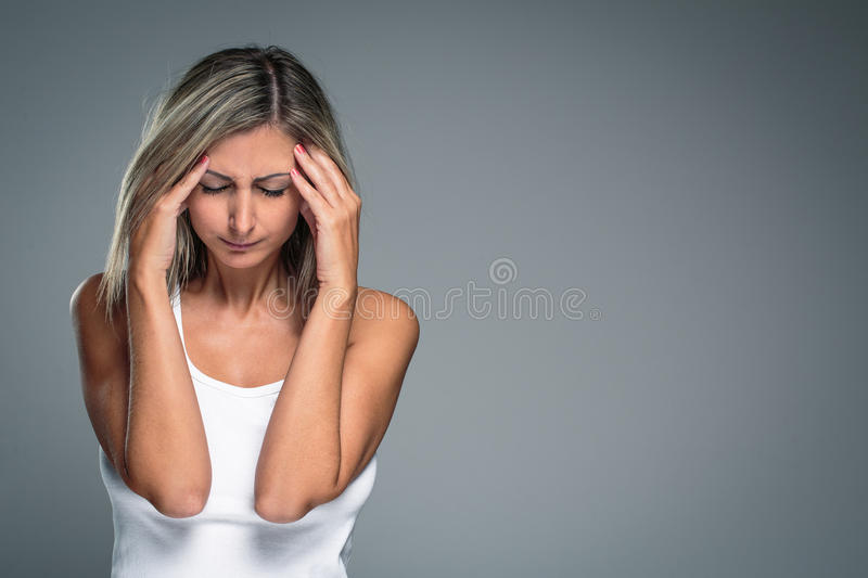 Gorgeous young woman with severe headache/migraine/depression royalty free stock photography