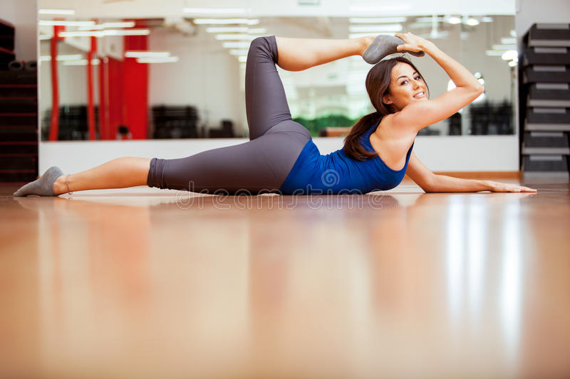 Gorgeous young woman stretching stock photos