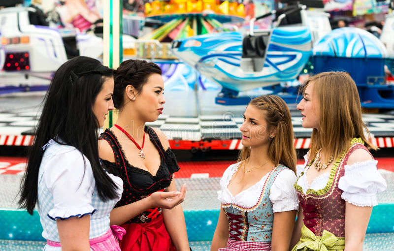 Gorgeous young women at German funfair stock images