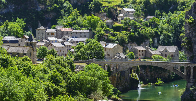 Gorges du Tarn. (Lozere, Linguedoc-Roussillon, France), famous canyon at summer. Village, bridge and canoes royalty free stock photo