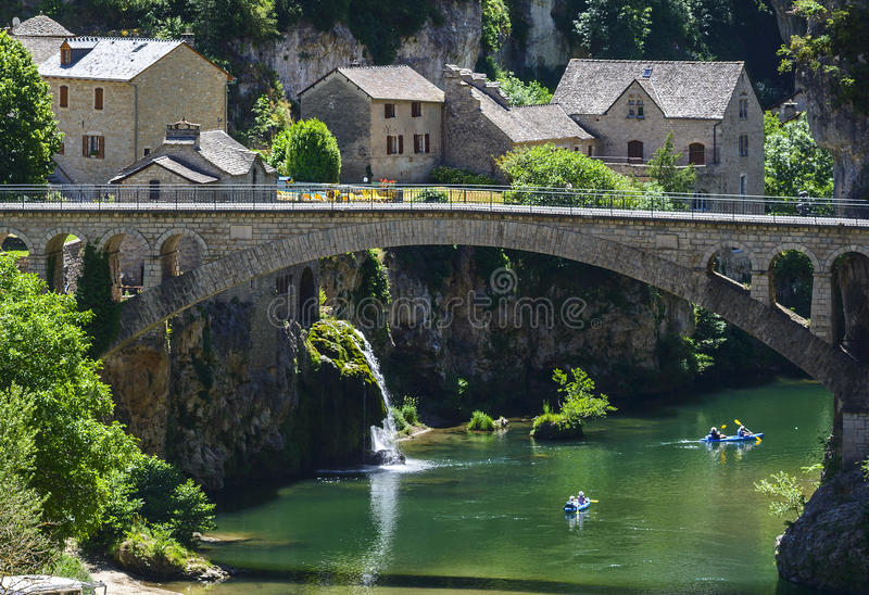 Gorges du Tarn. (Lozere, Linguedoc-Roussillon, France), famous canyon at summer. Village, bridge and canoes stock photography