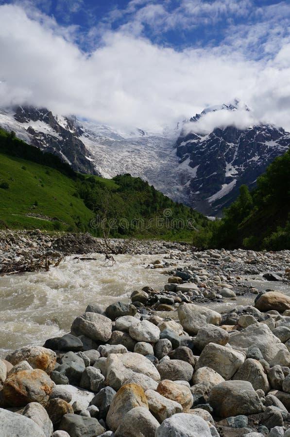 Gorgeus glacier Tetnuldi in Georgia with river stock images