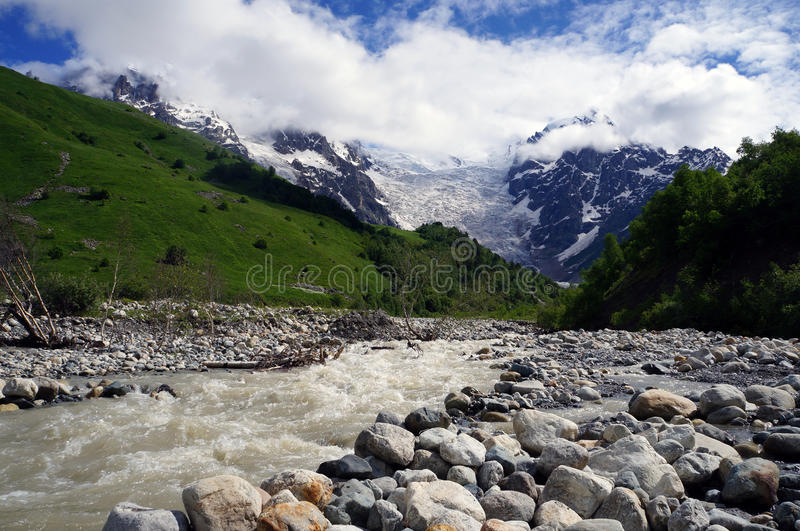Gorgeus glacier Tetnuldi in Georgia with river royalty free stock photos