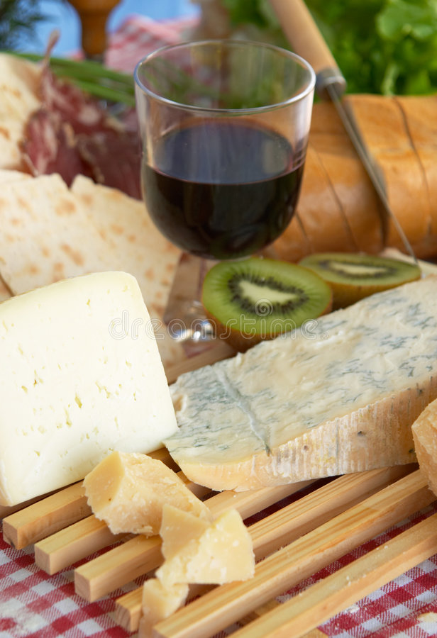 Gorgonzola, parmigiano, pecorino cheese, with wine and bread stock photos