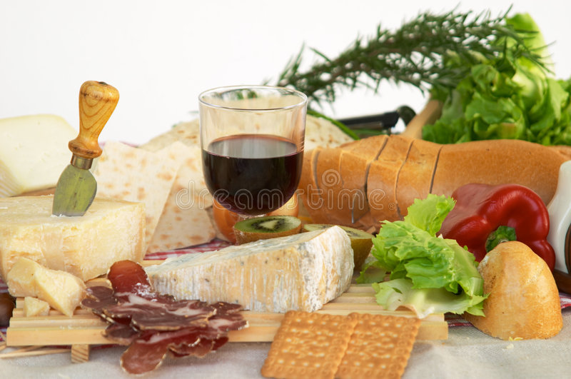 Gorgonzola, parmigiano, pecorino cheese, with wine and bread royalty free stock photos