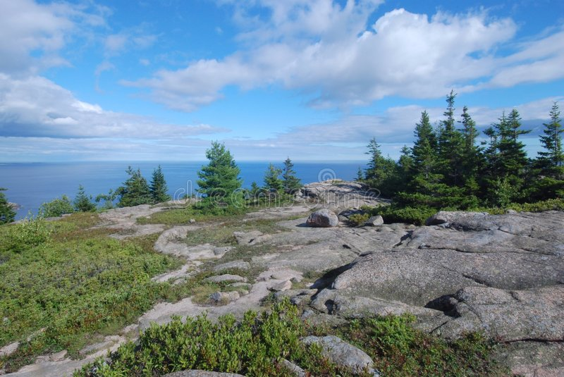 Gorham Mountain, Acadia. The Atlantic Ocean is seen in the distance from a hiking trail on the top of Gorham Mountain, captured in Acadia National Park in Maine royalty free stock image