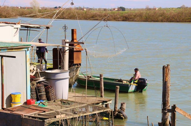 Fishermen on a boat in the region Delta del Po di Veneto. Italy. royalty free stock photos