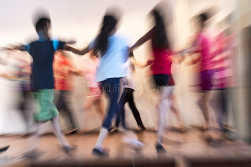 Goris, Armenia - June 16, 2017 - Motion blurred image of children practicing the dance stock images