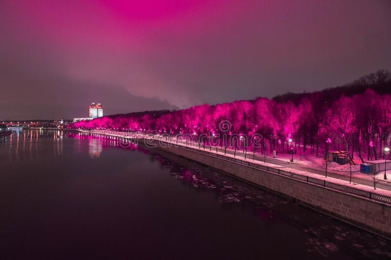 Gorky park in pink in purple lights. Central Park of culture and rest named after Maxim Gorky, abbreviated Gorky Park — Park in Moscow, one of the stock photo