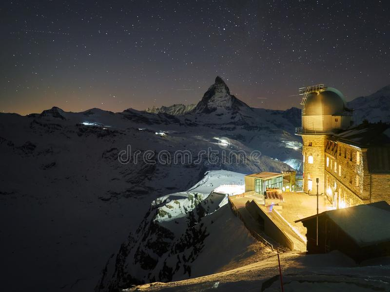 From the peak behind the Gornergrat Observatory and Matterhorn a breathtaking view of the most imposing mountain in Europe. The Gornergrat Observatory 3089 m / stock photo