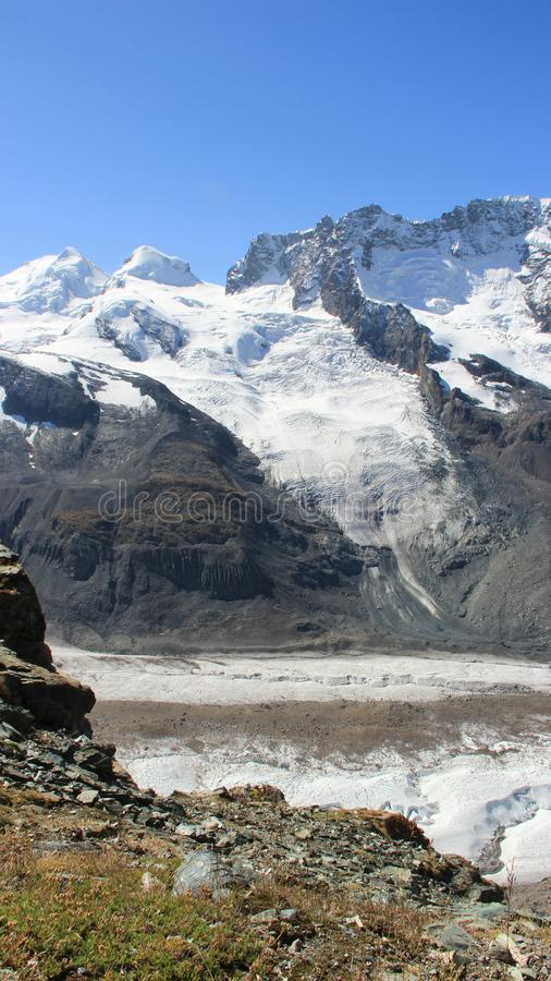 Gornergrat Summith. Glacier View In Sunny Day. Gornergrat glacier landscapes. rocky mountain cover by snow and ice with warm sunlight in summer time. Matterhorn stock photo