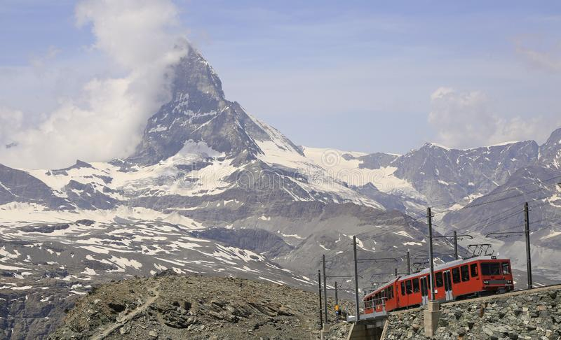 The Gornergrat train with Matterhorn in the background, Zermatt area, Switzerland. The Gornergrat railway is a mountain rack railway, located in the Swiss canton royalty free stock photography