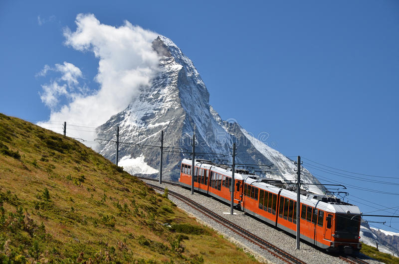 Gornergrat train and Matterhorn, Switzerland. The Gornergratbahn is a 9 km long gauge mountain rack railway, with Abt rack system. It leads from Zermatt (1604 m stock images