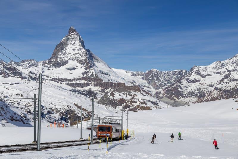 Gornergrat Train and people skiing in front of Matterhorn stock image
