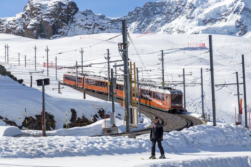 Gornergrat Train and ski piste in Matterhorn skking area royalty free stock photo