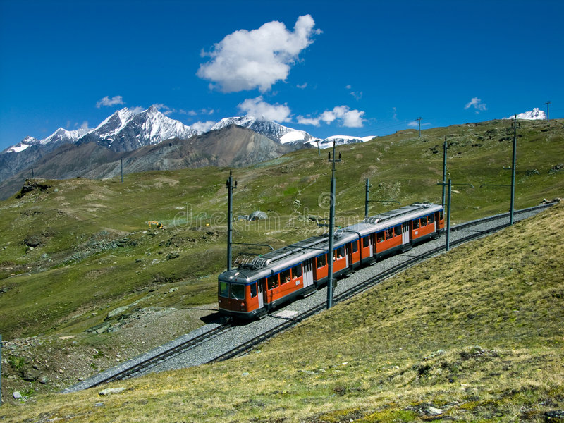 Gornergrat train to Zermatt. The Gornergratbahn is a 9 km long gauge mountain rack railway, with Abt rack system. It leads from Zermatt (1604 m), up to the royalty free stock image