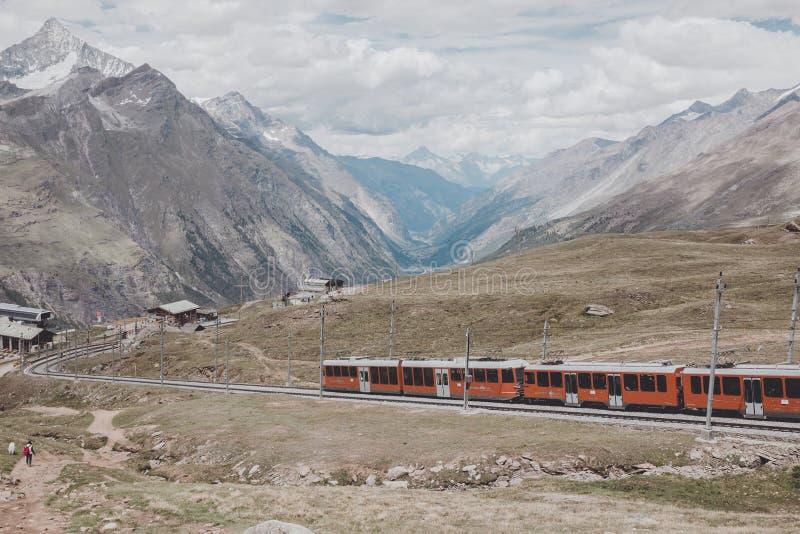 Gornergrat train with tourist is going to Matterhorn mountain stock image