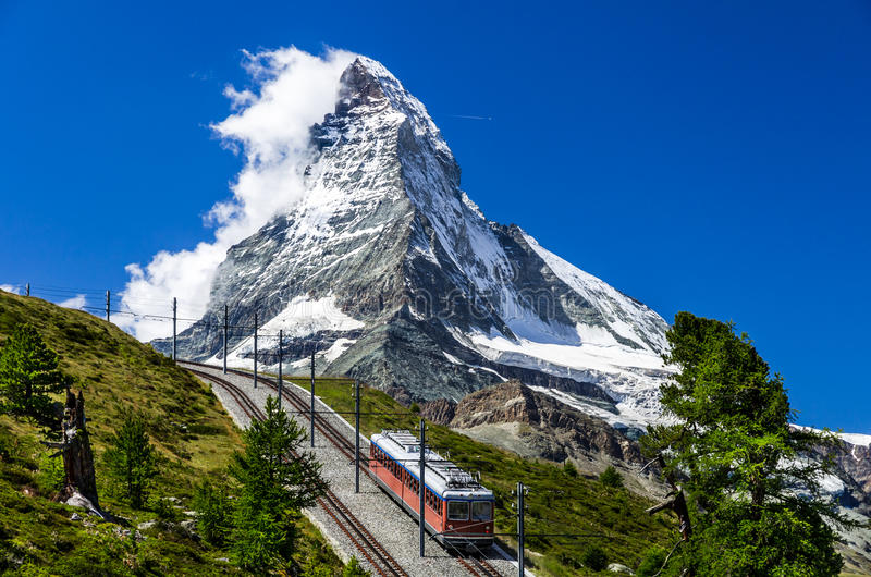 Gornergrat train and Matterhorn. Switzerland. The Gornergratbahn is a 9 km long gauge mountain rack railway, with Abt rack system. It leads from Zermatt (1604 m stock image