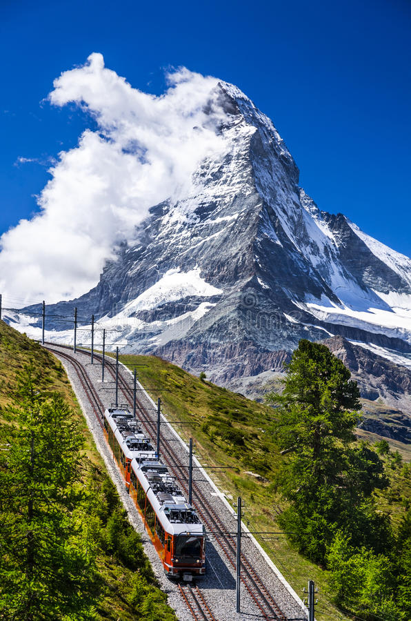Gornergrat train and Matterhorn. Switzerland. The Gornergratbahn is a 9 km long gauge mountain rack railway, with Abt rack system. It leads from Zermatt (1604 m royalty free stock image