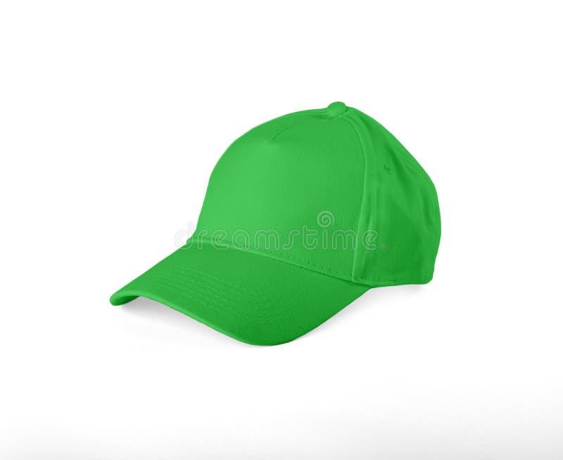 Gorra de béisbol verde en el fondo blanco imagen de archivo