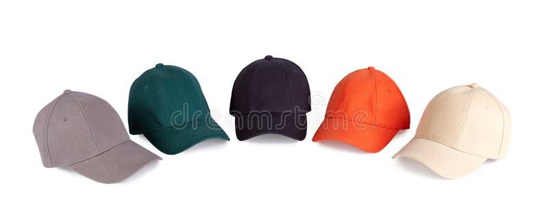 Gorras de béisbol del color imagenes de archivo