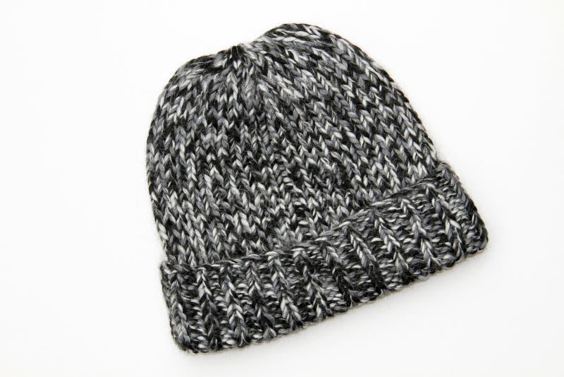 Gorrita tejida del sombrero del blanco gris del negro de las lanas del Knit del invierno fotografía de archivo libre de regalías