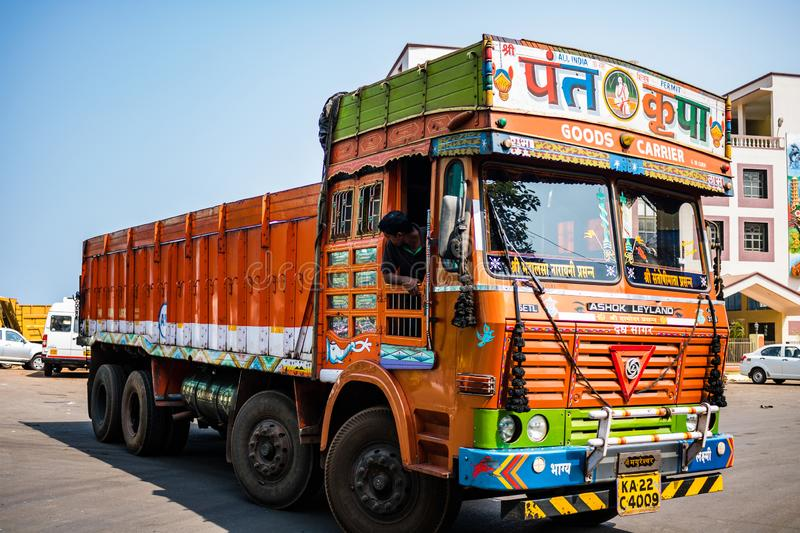 Gos, India - 2019. Colorful cargo truck under a summer blue sky with rich decorative paintings, typical for the trucks in India. royalty free stock photography