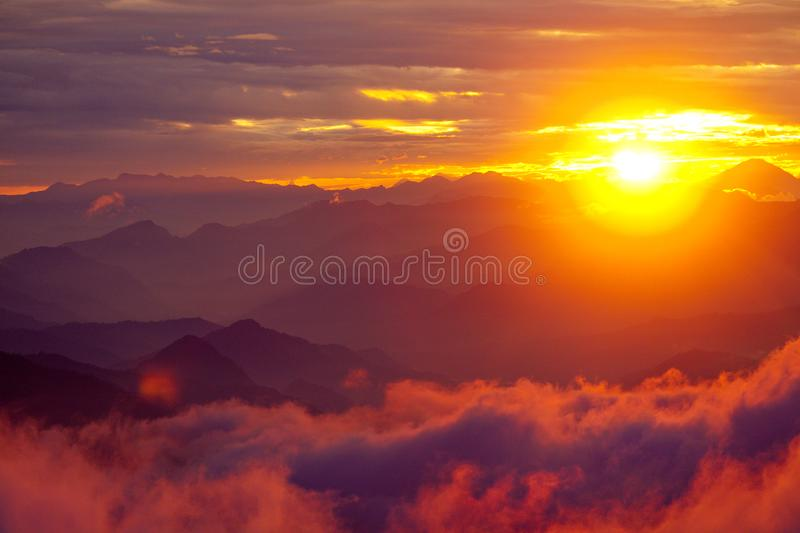 Orange sunset above mountain in valley Himalayas mountains royalty free stock images