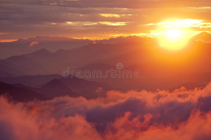 Orange sunset above mountain in valley Himalayas mountains royalty free stock photography