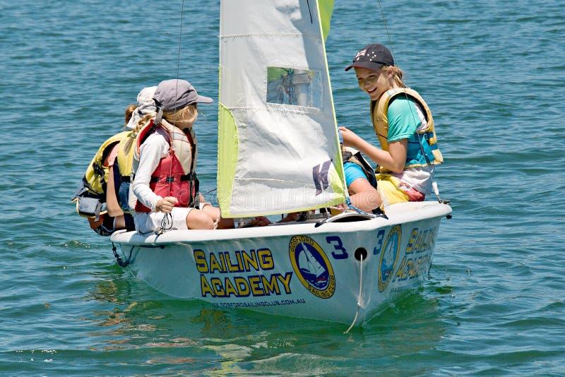 Gosford, Australia - January 1, 2014: Children sailing. Editoria. Gosford, Australia - January 1, 2014: Children sailing under supervision on Gosford Broad Water stock photos