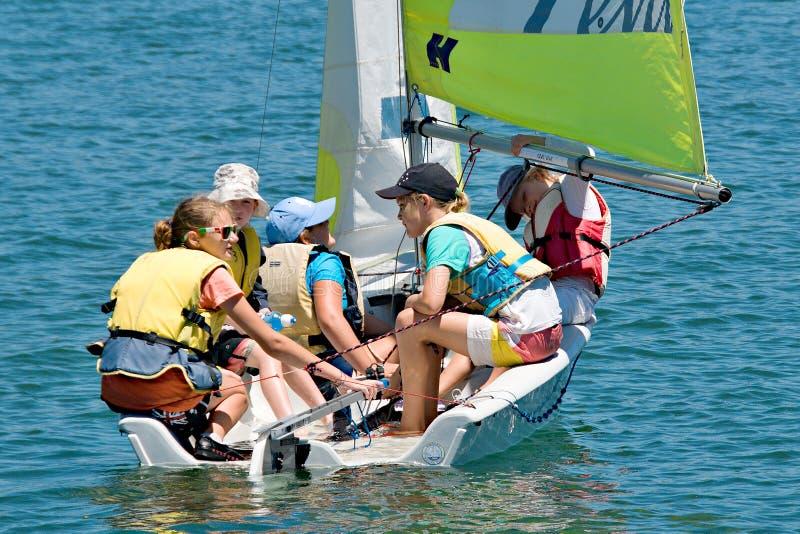 Gosford, Australia - January 1, 2014: Children sailing. Editoria. Gosford, Australia - January 1, 2014: Children sailing under supervision on Gosford Broad Water stock photo