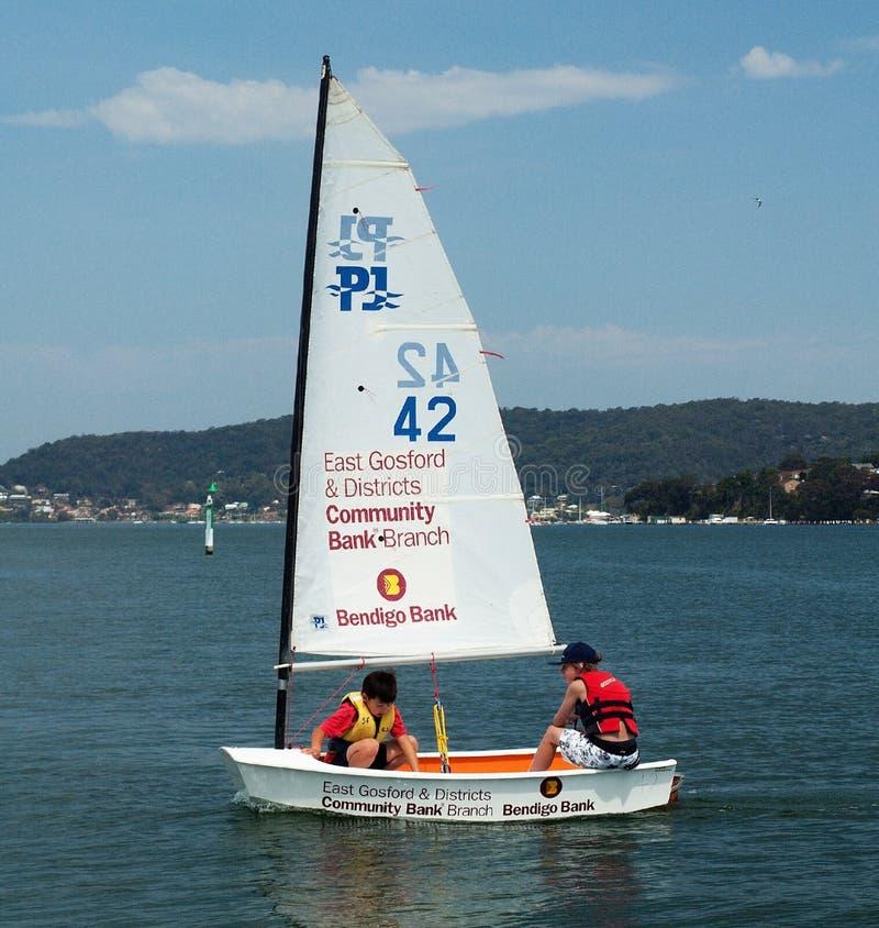 Gosford, Australia - September 27, 2012: Children sailing. Editorial. Gosford, Australia - January 1, 2014: Children sailing under supervision on Gosford Broad stock image