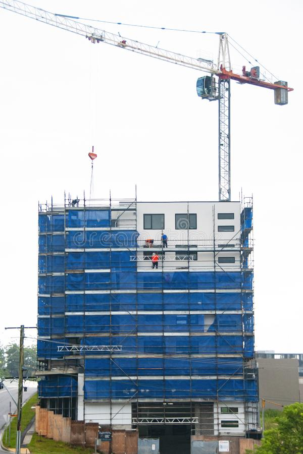 Building progress update 184. At 47 Beane St. Gosford. February 2019. Gosford, New South Wales, Australia - February 21, 2019: Removing scaffolding and safety stock photography