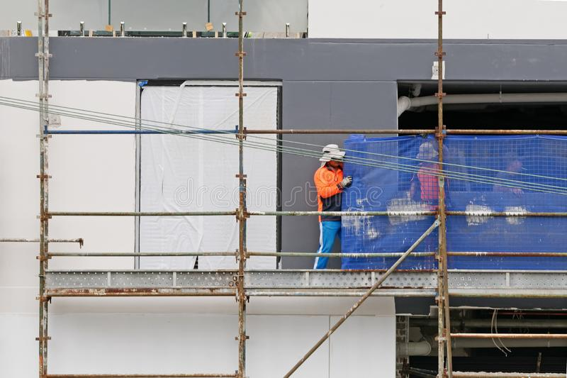 Construction Workers on site at 47 Beane St. Gosford. March, 2019. Building update 207. Gosford, New South Wales, Australia - March 6, 2019: Workmen close up stock image