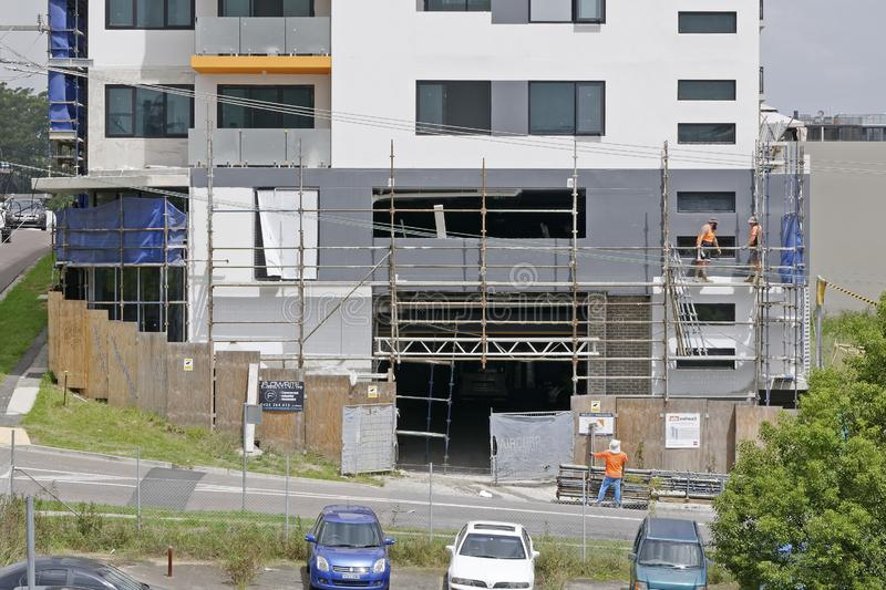 Construction Workers on site at 47 Beane St. Gosford. March, 2019. Building update 209. Gosford, New South Wales, Australia - March 6, 2019: Workmen dismantling stock photography