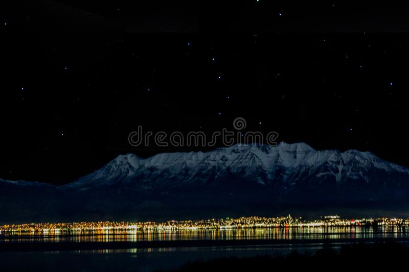 1-28-2018- Goshen,Utah/USA - Timpanogos from accross the lake at night with the stars and big dipper showing royalty free stock images