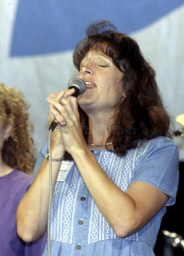 Gospel singer at a Christian festival. Woman singing gospel music, at a Christian festival in Indiana Pennsylvania royalty free stock images