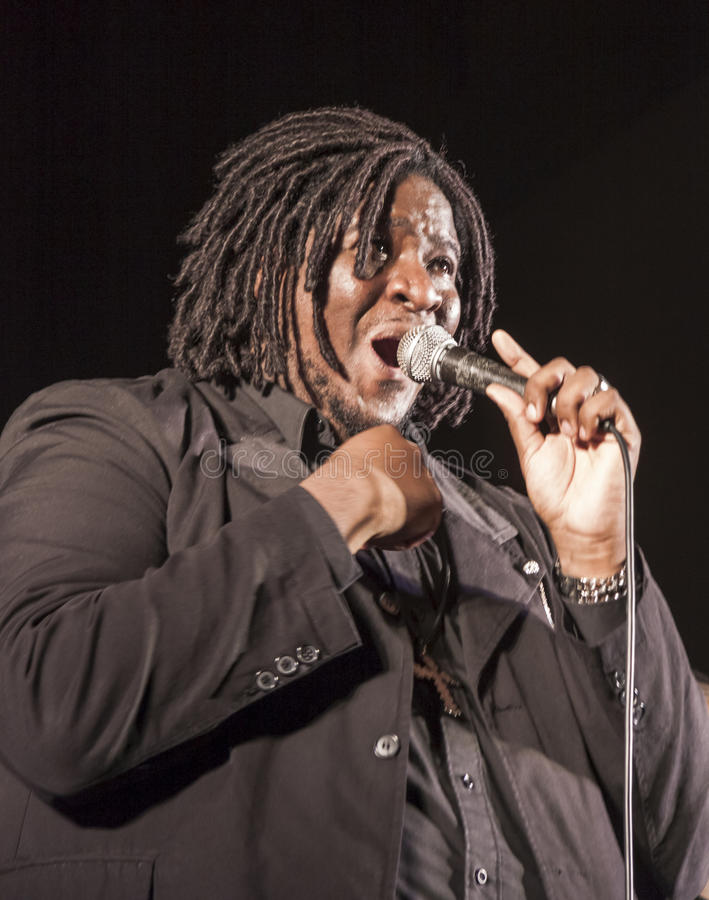 Gospel singer in concert. Gospel singer is singing during a concert in Roveredo in Piano (Italy royalty free stock photos